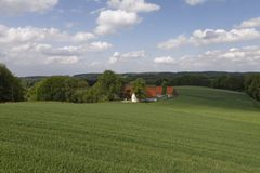 Farm in May, Osnabrueck country region, Lower Saxony, Germany Royalty Free Stock Photo