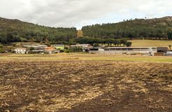 Farm in the meadows. Of the north of Spain in a cloudy day royalty free stock image