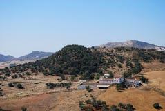 Farm in mountains, Almogia, Spain. Farm (Cortijo) amongst wheat fields and mountains, Near Almogia, Costa del Sol, Malaga Province, Andalusia, Spain, Western Stock Photo