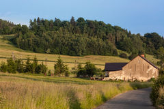 Farm in the mountains Kaczawskie. Western Sudetes, Kaczawskie Mountains, Village Swidnik, Poland, Lower Silesia Region. The month of June Stock Photos