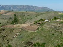 Farm in the mountains of Tajikistan. Farm on a hillside on the road from Dushanbe to the Nurek Tajikistan Stock Images