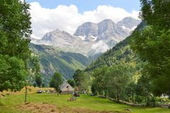 Farm near the Cirque de Gavarnie Hautes-Pyrénées, France. Farm near the `Cirque de Gavarnie` considered the largest cirque in the world and classified as a Royalty Free Stock Images