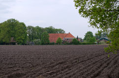 Farm in the Netherlands with plowed land Stock Photos