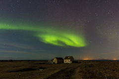 Farm and northern lights. Royalty Free Stock Image