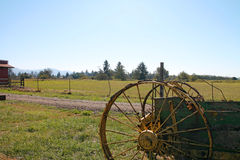 Farm and old farm equipment Royalty Free Stock Image