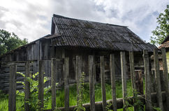Farm. Old rural homestead surrounded by trees Stock Image