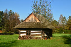 Farm. Old wooden farmhouse surrounded by Stock Photography