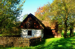 Farm. Old wooden farmhouse surrounded by greenery Stock Photo