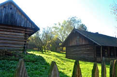 Farm. Old wooden farmhouse surrounded by greenery Royalty Free Stock Photo