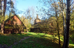 Farm. Old wooden farmhouse surrounded by greenery Royalty Free Stock Images