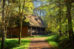 Farm. Old wooden farmhouse surrounded by greenery Stock Photography