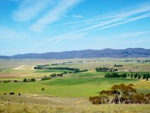 The farm. Over looking the farm  with trees and mountains Royalty Free Stock Photo