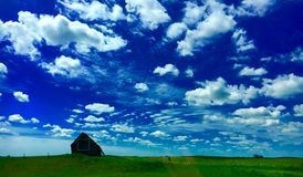 Farm On The Plains. A farm with a barn on the Great Plains Stock Photography