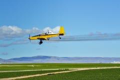 Farm plane sprays his fields Stock Photography