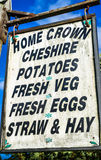 Farm Produce. A rustic sign outside a farm selling various produce Stock Image