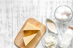 Farm products. Milk, cottage, eggs, cheese on light wooden background top view copyspace Stock Photo