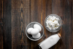 Farm products. Milk,cottage, eggs on dark wooden background top view copyspace Stock Image