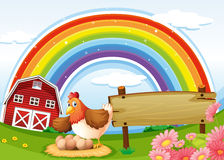 A farm with a rainbow and an empty signboard Royalty Free Stock Image