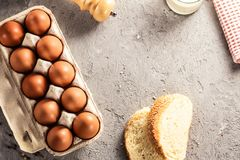 Farm raw fresh egg in pack bread milk on gray table scrambled eggs omelet fried egg Royalty Free Stock Photography