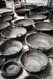 Farm receptacles made of used tyres. On sale at Saquisili market, Ecuador Stock Images