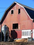 Farm: red gabled barn. New England gabled barn with red corrugated iron cladding Stock Photography