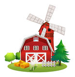 A farm with a red house and a windmill Stock Photography