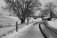 Farm road after a snow. A rural farm scene after a light morning snow Stock Photography