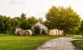 Farm road. Straw bales on the farm Royalty Free Stock Photo