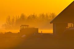 Farm scene. During orange sunset Royalty Free Stock Photos
