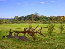 Farm Scene. Scene of vintage farm equipment on a country field Stock Image