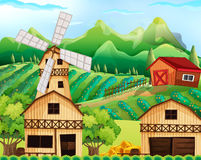 Farm scene with barn and windmill Stock Photography