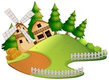 Farm scene with barn and windmill Stock Photos