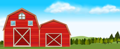 Farm scene with barns in field Royalty Free Stock Image