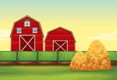 Farm scene with barns and haystacks Stock Image