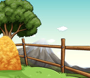 Farm scene with haystack by the fence Stock Image