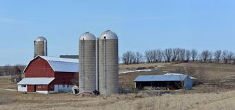 Farm scene in the hills of southern wisconsin. With 3 silos and barn stock photos