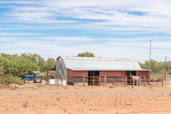 Farm scene with tractor, barn and horse Stock Photos