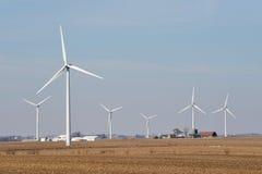 Farm scene with wind turbines Royalty Free Stock Image