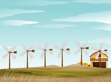 Farm scene with windmill and barn Royalty Free Stock Photography