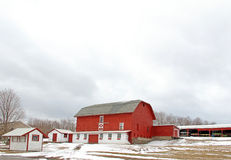 Farm scenic in winter upstate rural New York. Red barn and farm in winter Royalty Free Stock Photos