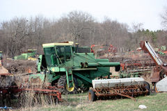Farm Scrap. A rusted tractor waits at the scrap yard to be recycled Royalty Free Stock Photo
