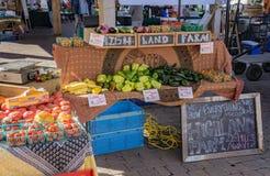 A Farm Selling It's Produce. Blacksburg, VA – August 5th: A local farm selling it's farm fresh vegetables at the Blacksburg Farmers Market located in Royalty Free Stock Photography