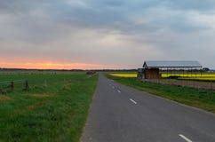 Farm shed near Ballarat, Australia. A farm shed in a yellow canola field, near Ballarat, Australia stock photography