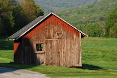 Farm Shed on a Sunny Day. Old red farm shed standing in the sun Royalty Free Stock Photos