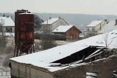 Farm silo under the snow. Two rusty silo under the snow Stock Photo