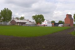 Farm and Small Town. View of a small town from a field Stock Photos