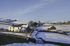 Farm in snowy countryside Stock Images