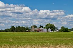 A farm in southern Ohio near Plan City. This is a picture of a farm near Plain City, Ohio on a sunny day with clouds Royalty Free Stock Image