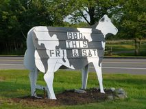 Farm-stand: cow sign barbecue. New England farm-stand cow sign advertising barbecue Royalty Free Stock Photo