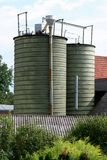 Farm storage silos. Two storage silos for grain or feed on a small farm Royalty Free Stock Photo